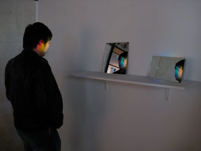 Strategically placed prism and mirrors casts a spectrum on participants\' faces.