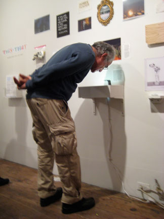 A visitor inspects Antony Hall's Hele shaw cell experiment.