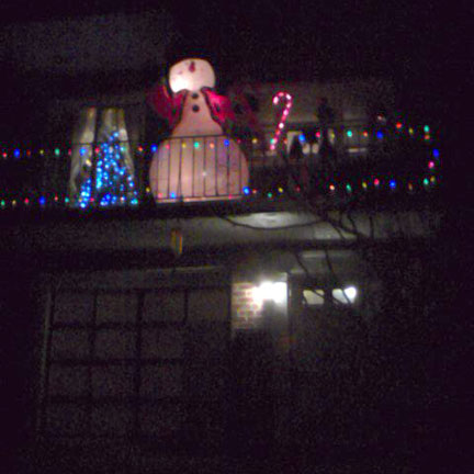 Pre-blizzard: Inflatable snowman on a balcony.
