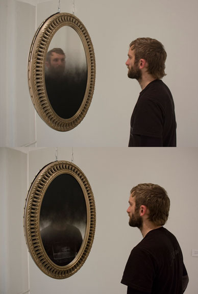 mirrorsblackportrait, 2011, mirrors, paint, frames, wire, motor, hardware; 112 x 21 x 21 in / 2.8 m x 0.5 x 0.5 m (site variable).