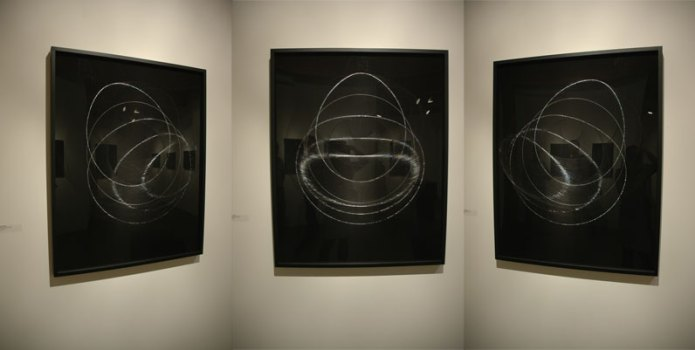 James Minden's etched/scribed black plexiglas works; three perspectives on the same work.
