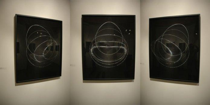 James Minden's etched/scribed black plexiglas works; three perspectives on the same work.