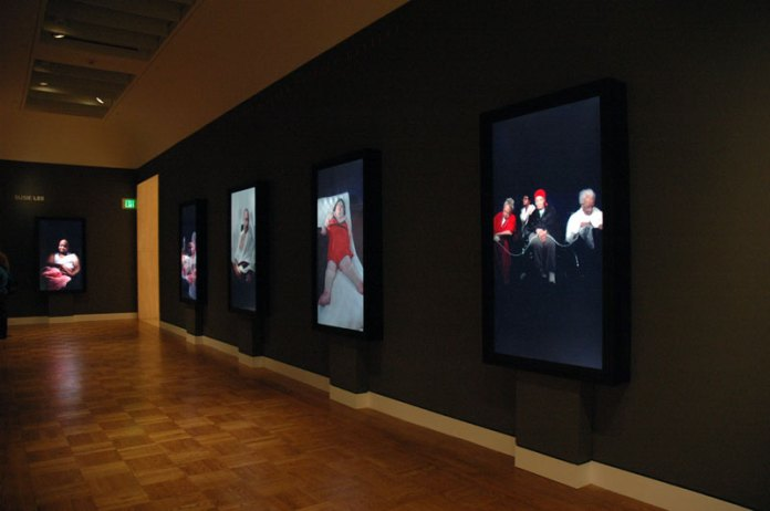 Hall of video portraits. Susie Lee. Portland Art Museum.