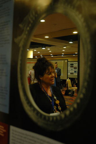 Gina Haines' poster on positive psychology and phenomenology featured a foil mirror.