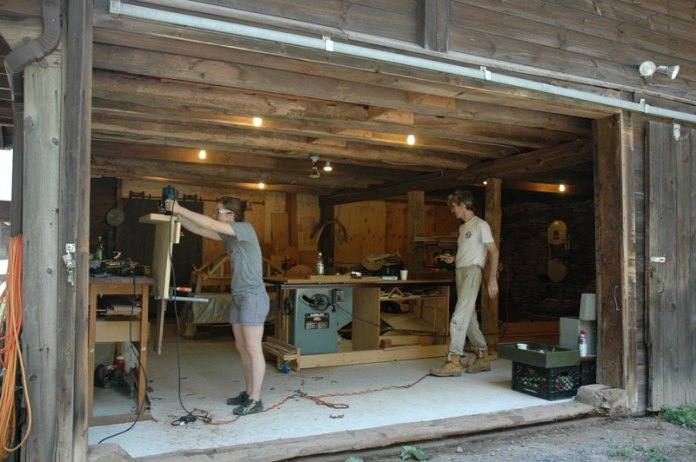 Paul and Jessica in the woodshop. That day's lesson: using routers and jigs to machine dovetails.