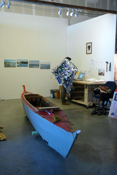 Studio visit with Michael Arcega. Baby, the artist-designed and -made collapsible, outrigger canoe, under a pinata-disco ball-hybrid. Not to mention an envy-inspiring woodshop in the studio.
