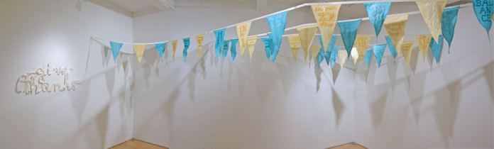 Give Thanks, 2011 site-specific installation of 39 pennant flags: satin ribbon, linen, gratitude statements, dimensions site-variable.