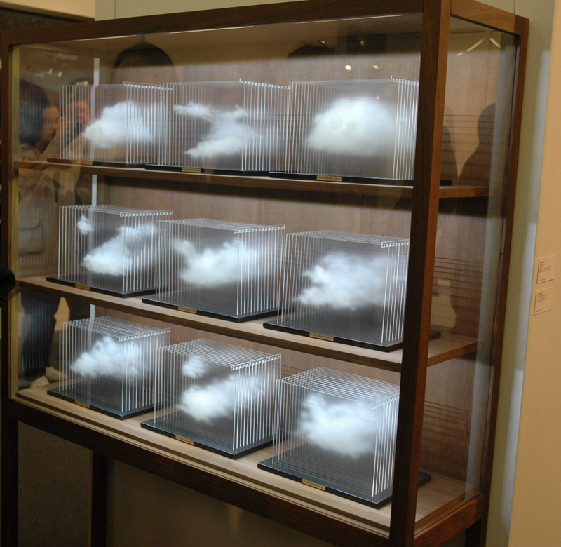 GOOD IDEAS. Leandro Erlich's cloud case. Spraypaint on layered acrylic sheets. Brilliant. The cabinet makes it. Sean Kelly Gallery, New York.