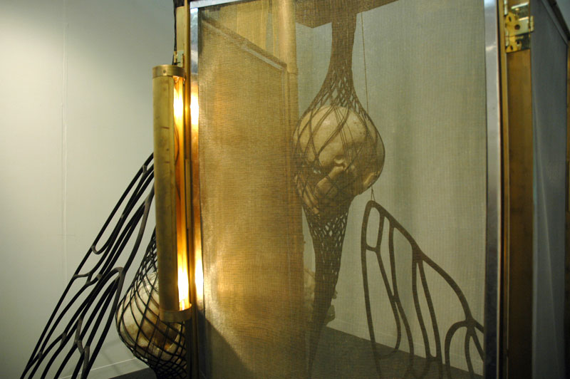 Gold wire screen used for glamorous obscuration. Installation by Tunga, Mendes Wood Gallery, Sao Paolo.