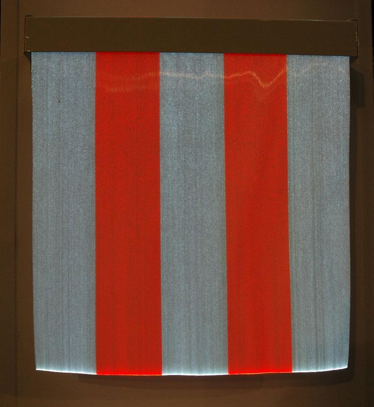 Fiber optic fabric, lit by LEDs. Yes! No black light. Stripes by Daniel Buren, Lisson Gallery.