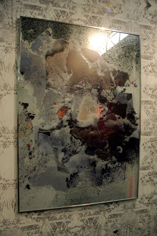 Mirrors with images, possibly direct-to-substrate printing; it's got that pebbly sheen. I couldn't figure out who this is. Rashad Newsome, maybe? Marlborough Gallery, Chelsea, NY.