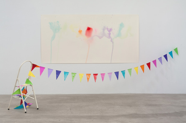 Amalia Pica, Some of that Colour #4, 2011. Paper flags, drained paper flag dye on watercolor paper, chair. 78 x 155 x 60.5 inches. // Source: MarcFoxx.com.