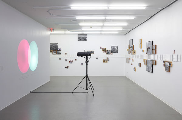 Installation view of the Ungovernables at the New Museum, NY. Foreground/left: Amalia Pica, Venn diagrams (under the spotlight). 2011 Installation with spotlights, motion sensors and text. // Source: NewMuseum.org.