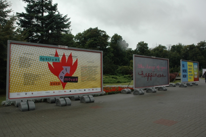 Billboards by Christine Wong Yap (center) and Susan O'Malley (right). Art Moves Festival, Fryderyka Chopina, Toruń, Poland