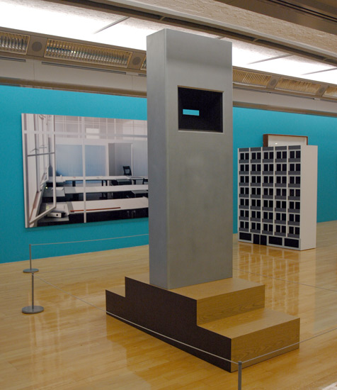 Richard Artschwager, Tower II, 1979 (center), with a photo by Thomas Demand (left) and Julian Opie's You See An Office Building 4 (1996). Tate Liverpool.