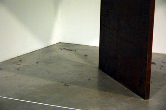 Dust bunnies under a Richard Serra sculpture at the Tate Modern. Good decision to leave it as is. Would you want to sweep under a massive sheet of steel that is not fastened to anything?
