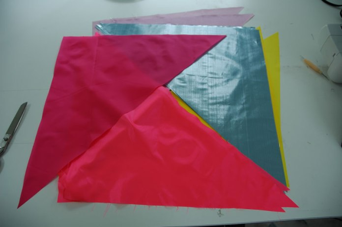 Parts of a flag-to-be; cut.
