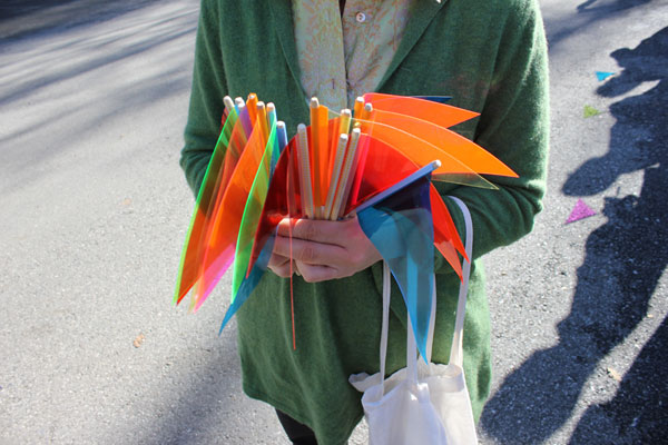 Lucas Artists Residency Program Director Kelly Sicat distributed mini vinyl flags for the public to use for voting.