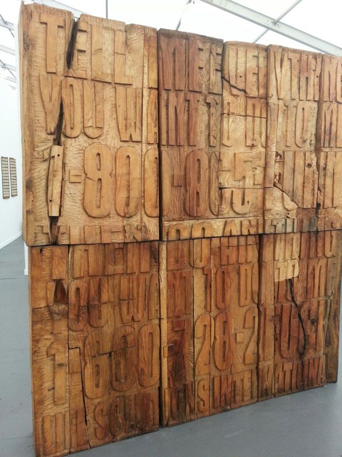 Cameron Platter's monumental wood text at Whatiftheworld/Gallery (Cape Town). Another puzzle in terms of content, and yes, the scale suits the obviousness of fairs. But it is pretty smart to appeal to people's love (or fetish?) of wood type, and use condensed gothic typography.