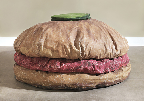 "Claes Oldenburg. Floor Burger 1962 Canvas filled with foam rubber and cardboard boxes, painted with acrylic paint. 52"" x 7' x 7' (132.1 x 213.4 x 213.4 cm). Collection Art Gallery of Ontario, Toronto. Purchase, 1967. © 1962 Claes Oldenburg. Photo: Sean Weaver. // Source: moma.org."