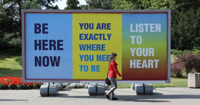 Susan O'Malley, Inspirational Posters: Be Here Now, You Are Exactly Where You Need to Be and Listen to Your Heart billboard, Rapackiego Square, Art Moves Festival, Toruń, Poland