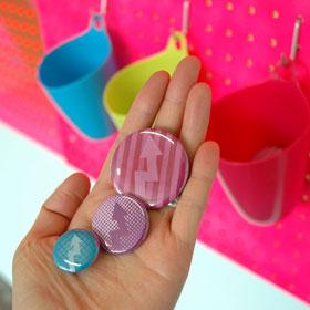Christine Wong Yap, Irrational Exuberance (Asst. Colors) buttons #1–3, 2010, badges, 1–1.75 inches / 2.5 x 4.5 cm dia. each.
