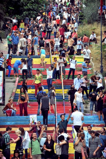 People paint rainbow-colored stairs on August 31, 2013 in Istanbul. Stairs in the Cihangir and Findikli neighborhoods, which attracted attention after being painted in rainbow colors by a local man on August 27, were all painted grey on the night of August 29, and following comments on social media, the municipality of Beyoglu immediately painted them again in rainbow colors. // Source: Ozan Kose / AFP / Getty Images. From Huffington Post.