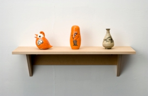 Haim Steinbach, Untitled (bird, nesting dolls, vase), 2006  MDF shelf; ceramic bird; wooden nesting dolls; Korean ceramic vase 11-3/4 x 33 x 10-1/2 in. (30 x 84 x 27 cm). // Source: HaimSteinbach.net.