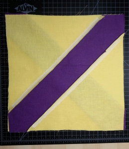 Sewing on the bias (the stretchy direction) is hard! Fusible interfacing makes it easier.
