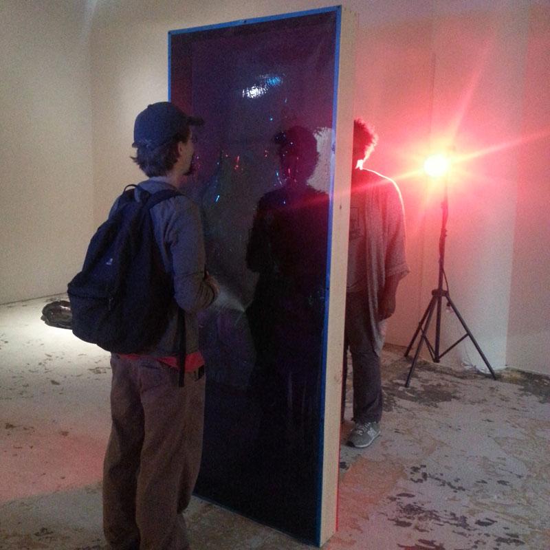 BZ & NM viewing Doorway, 2014, wood, vinyl, asphalt-based coating, lights, stands, gels, door: 82.5 x 33.5 x 5.5 inches / 210 x 85 x 14 cm