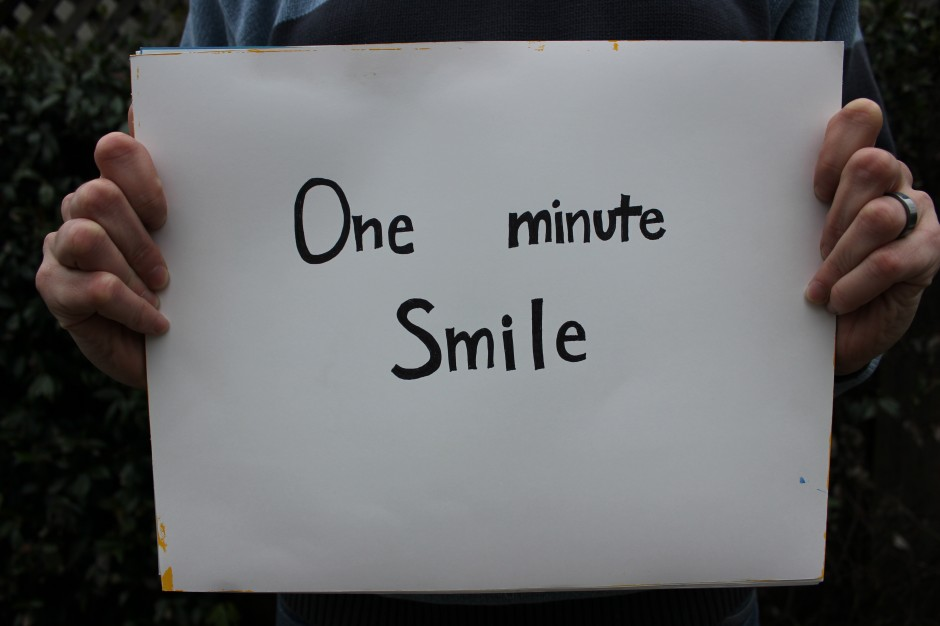 Susan O'Malley, One Minute Smile (participatory performance documentation), 2013
