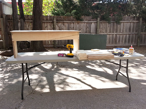 Making a bench in Harvester's back patio on a sunny day.