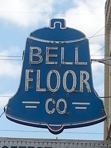 Neon sign in the Delano district. Bell Floor Co.