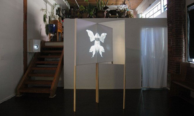 Christine Wong Yap, Projection, 2014, video installation: video, wood, fabric, acrylic, 80 x 32 x 32.125 inches.  Installation view at Portland 'Pataphysical Society, Portland, OR