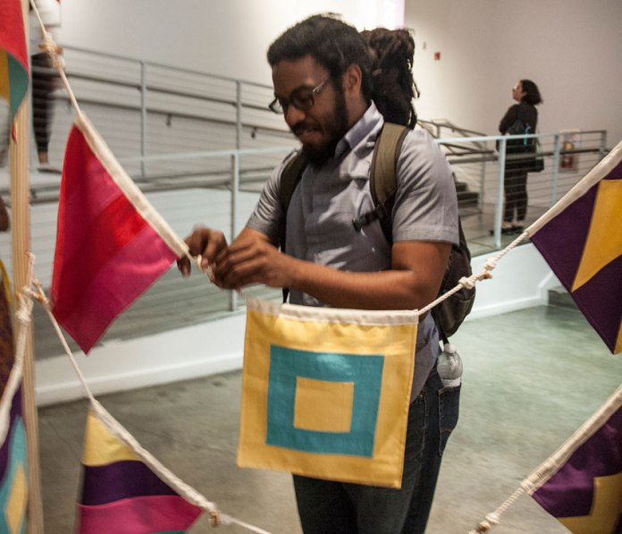 Participants are invited to string together the flags representing  their strengths. Connect the toggles to the loops.