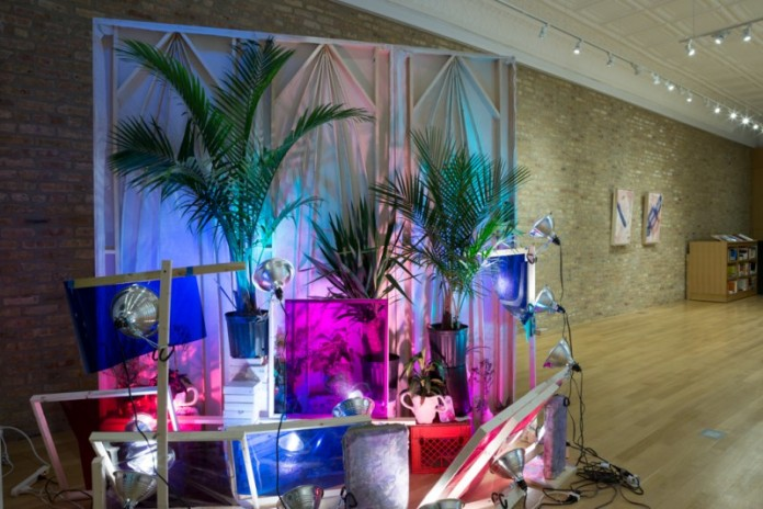 """Sri Chowdhury, """"Affected Painting,"""" site specific installation, 2015. Wood, linen, oil paint, concrete, plants, light gels, shadows, ceramics, dimensions variable. Photo by Clare Britt. // Source: cocopicard.com."""