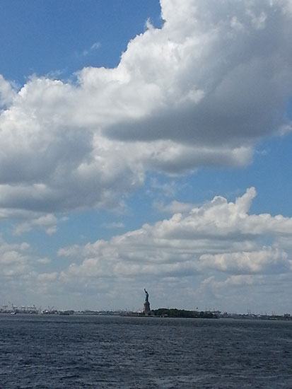 The Statue of Liberty seen from the ferry on a beautiful day.