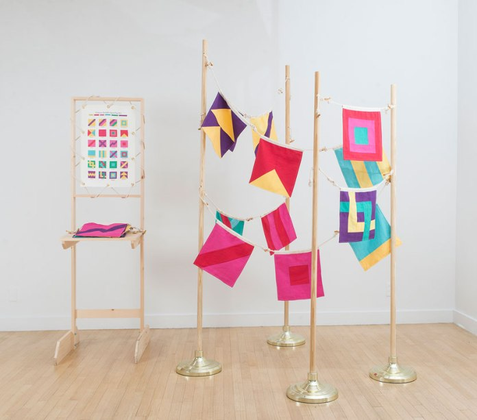Christine Wong Yap, Character Strengths Signal Flags, 2015, linen, twill tape, letterpress-printed ribbon, rope, wood, flagpoles; 24 flags: 12.5 x 12 inches each; edition of three; flagpoles: 72–84 x 12 x 12 inches each; display: 73.5 x 20.5 x 27 inches. Photo: Anna Ablogina.
