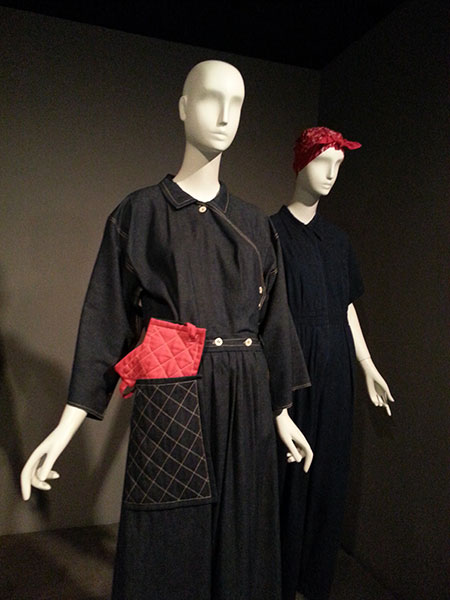 "Front: Reproduction of Claire McCardell's ""Popover"" dress, circa 1942, blue denim and red cotton. Also: denim jumpsuit, as women joined manufacturing for WWII."