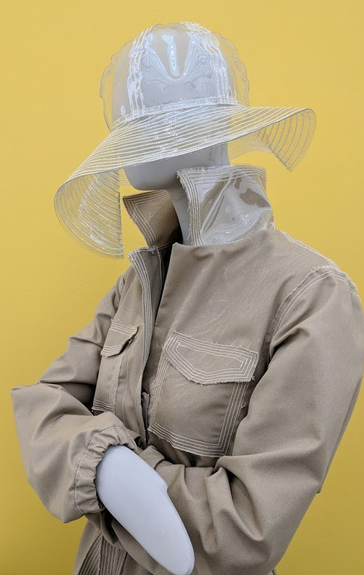 """Rainwear garments made of recycled bottles, designed by Tracy Reese and sewed by a women's empowerment organization in Detroit. Mel Chin, """"Flint Fit,"""" (2018-ongoing). // Photo: CWY."""