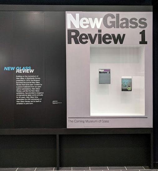 "A case with ""New Glass Review 1"" in vinyl, displaying the first and most recent issues of New Glass Review."