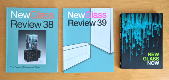 Three books, with images of glass sculptures and installations on the cover.